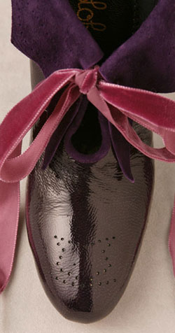 purple patent leather booties detail
