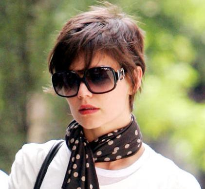 The interest in Katie Holmes's hair never ends. She just keeps going ...